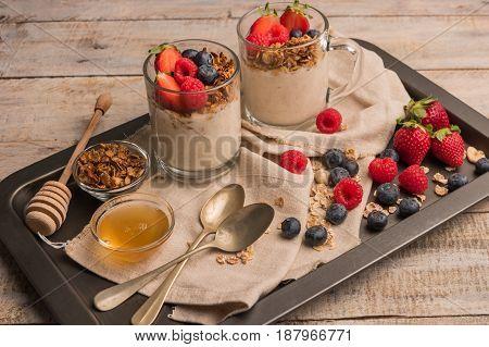 Breakfast parfait with homemade granola fresh fruits and yogurt