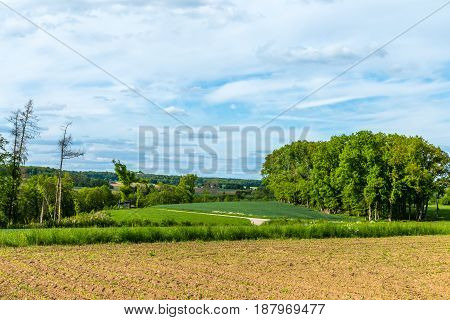 Landscape Of A Forest, Small Green Shed, Plantation Crop Furrows And A Great Sky With Dramatic Cloud