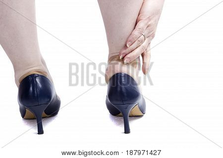 Female feet with plaster in blue shoes