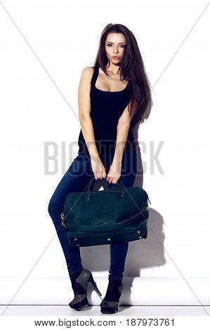 young beautiful girl holding reptile leaher bag