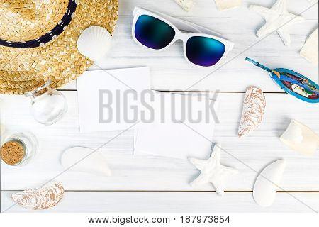 Summer Beach Accessories (white Sunglasses,starfish,straw Hat,shell) And Photo Frame On White Plaste