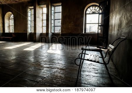 wooden chair in grungy interior. Loneliness estrangement alienation concept.