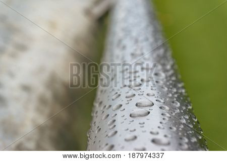 Water Droplets On Metal Handrail