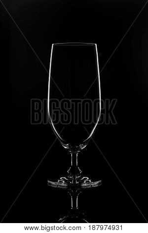 Transparent glass for wine on a black background.