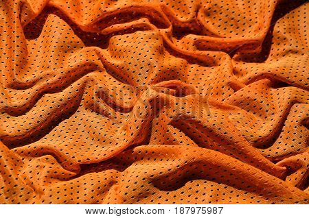 Sport Clothing Fabric Texture Background. Top View Of Orange Polyester Nylon Cloth Textile Surface.