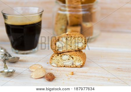 Homemade biscotti cantuccini or cantucci Italian almond sweets biscuits (cookies) and glass of espresso coffee. Copy space.