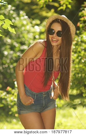 portrait of young beautiful sexy woman posing in green leaves at summer