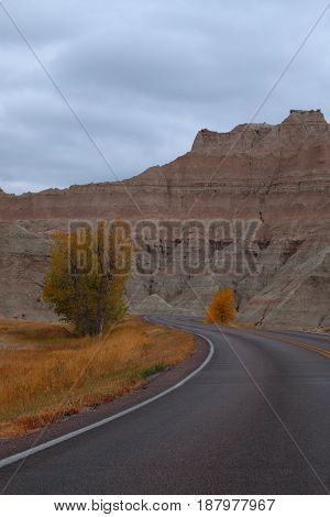 Winding road through Badlands National Park with fall colors
