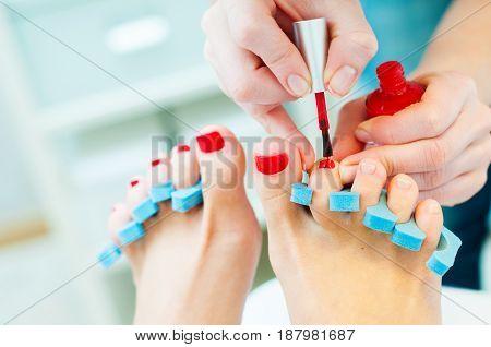 Photo of getting pedicure procedure in process