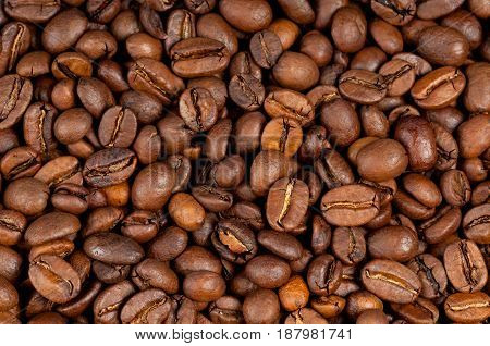 Macro photo of rosated coffee beans background