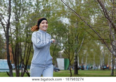 Beautiful Sports Girl Runs In Park And Listening To Music