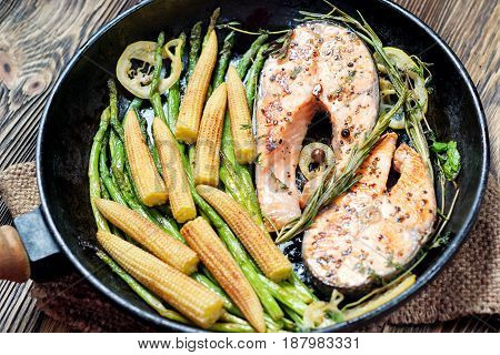 Salmon Steak, Fried With Herbs, Pepper And Lemon.