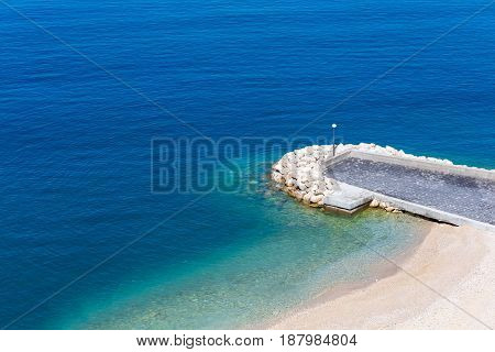 Top aerial view of empty beauty beach in Italy, Europe.