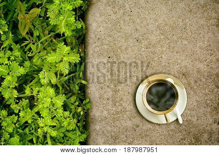 Black coffee on the cement floor. Top view.