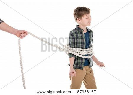 Cropped shot of father holding rope and tied little son family problems concept