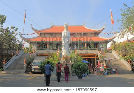 HO CHI MINH CITY VIETNAM - NOVEMBER 28, 2016: Unidentified people visit Vinh Nghiem pagoda temple Ho Chi Minh City Saigon Vietnam