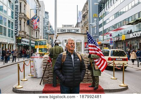 Tourists On The Street Near Checkpoint Charlie In Berlin City In