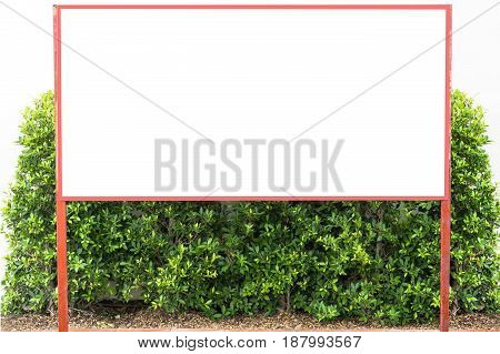 Blank billboard on green grass in park to place your logo or advertising on it
