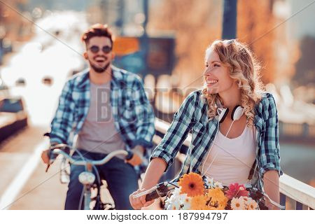 Couple riding their bikes in their free time and having fun on a sunny summer day.