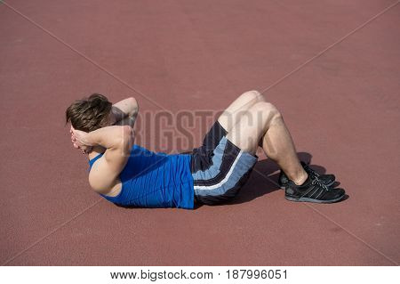 Athletic Bearded Man With Muscular Body Doing Exercises For Abdominal