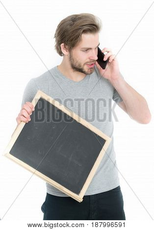 Man With Smartphone And Blackboard