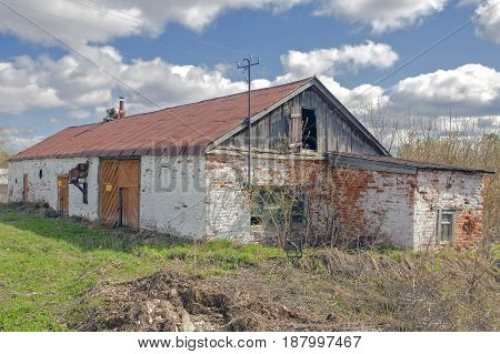 Old Barn Of Red Brick In A Rural Location