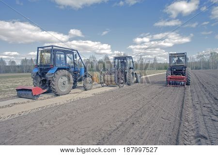 Farm Tractor Plowing In The Field