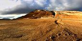 Otherworldly and barren geothermal landscape of Hverir Iceland poster