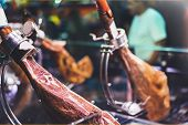Spanish hamon in barcelona market jamon iberico in view black leg pork isolated traditional national spain meat in store serrano prosciutto food on background gastronomy bacon berian on cuisine poster