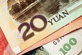 Chinese paper yuan currency close up in macro poster