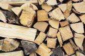 firewood background - split hardwood kiln-dried. split firewood in the stack poster