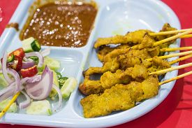 Pork Satay. grilled pork served with peanut sauce or sweet and sour sauce.
