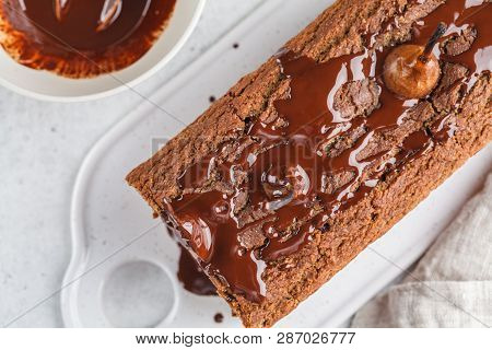 Chocolate Pear Cake On A White Board, White Background. Fruitcake With Chocolate.