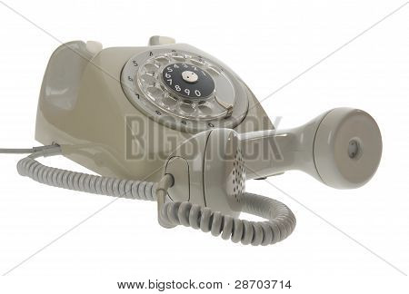 An Old Gray Vintage Rotary Style Telephone With The Handset Off The Hook