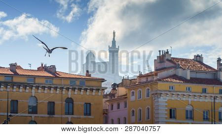 Basilique Notre-dame De La Garde In The Foggy Background With Red Tiled Roof Marseille Houses