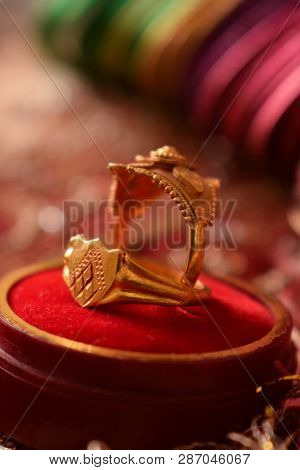 Indian Wedding Ring. Close-up Image Of Indian Wedding Rings Symbolizing Love, Commitment With Soft B
