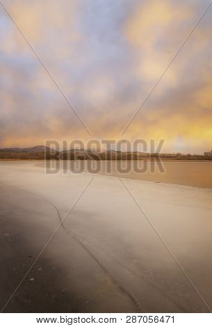 Sunrise On A Frozen Lake