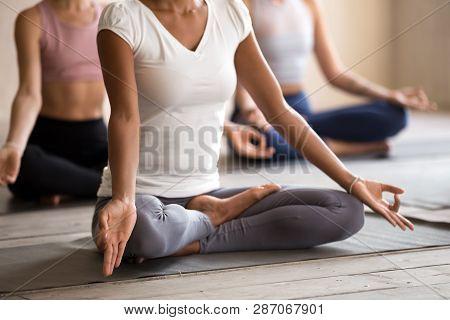 Yogi Black Woman Practicing Yoga Lesson, Ardha Padmasana Pose