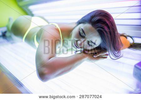 Beautiful Young Woman In Bikini Have Tanning Skin Treatment In Modern Solarium