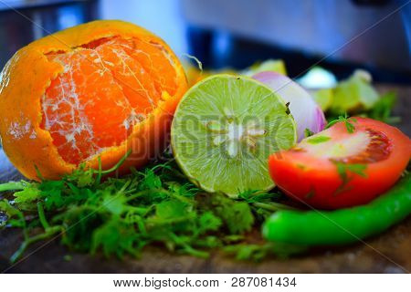 Orange, Lemon, Tomato And Chilli. Freshly Cutted Juicy, Raw Fruits And Vegetables For Preparation Of