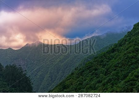 Orange Clouds In The Blue Sky Over Forested Mountains. View From Balcoes Viewpoint In Ribeiro Frio O