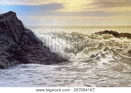 Waves On The Rocky Coast At Golden Hour. Portuguese Island Of Madeira