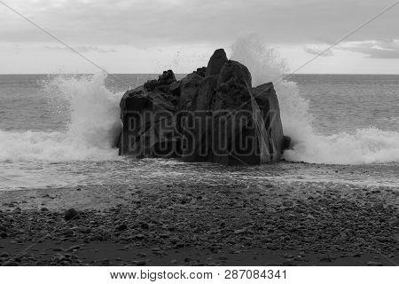 Waves Breaking At The Rock On Stone Coastline. Praia Formosa Beach In Funchal, Portugal