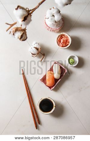 Sushi Set Nigiri With Salmon And Butterfish In Pink Ceramic Serving Plate, Chopsticks, Bowls Of Soy