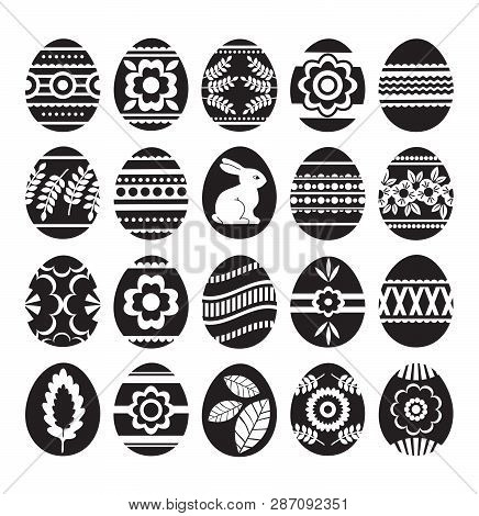 Silhouettes Of Black Easter Eggs Isolated On White Background. Holiday Easter Eggs Decorated With Fl
