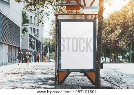 A City Bus Stop With The Clean Placeholder Template; Advertising Empty Poster Mock-up In Urban Setti