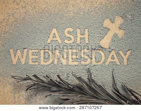 Ash Wednesday Concept - Ash Wednesday Words And A Cross Formed Out Of Ashes. There Are Dry Palm Leaf