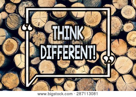 Writing note showing Think Different. Business photo showcasing Rethink Change on vision Acquire New Ideas Innovate Wooden background vintage wood wild message ideas intentions thoughts. poster