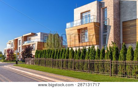 Townhouses In Town Or Village. Panorama Of The Modern Houses In Summer. Street With Contemporary Tow