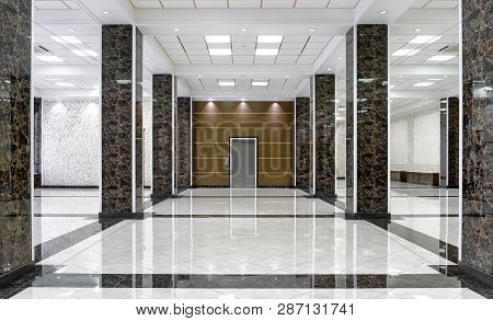Marble Interior Of A Luxury Lobby Of Company Or Hotel. Clean Corporate Hallway With Real Floor Tile.